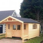 Garden Log Cabins with roof over hang and black felt shingles