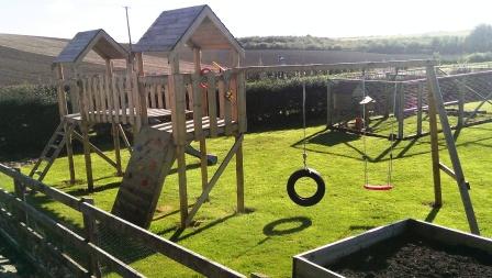 Wooden climbing frame and garden