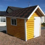 Childrens playhouses - crooked cottage with log effect cladding