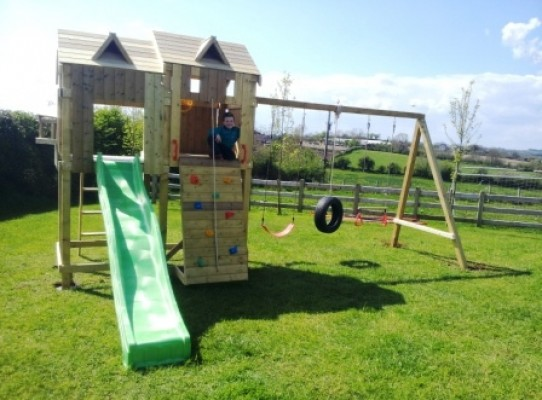 climbing frame with double look out tower and triple swing set