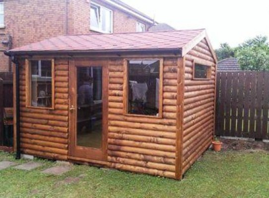 Garden room with log cladding finish and red shingle roof.