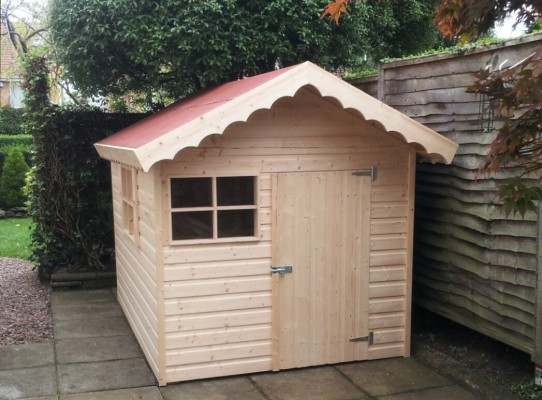children's playhouse with red felt roof