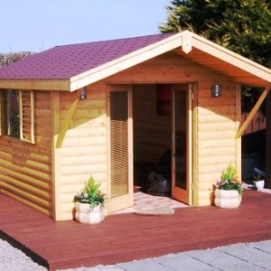 Log Cabin Garden Rooms with brown felt shingled roof and front decking area