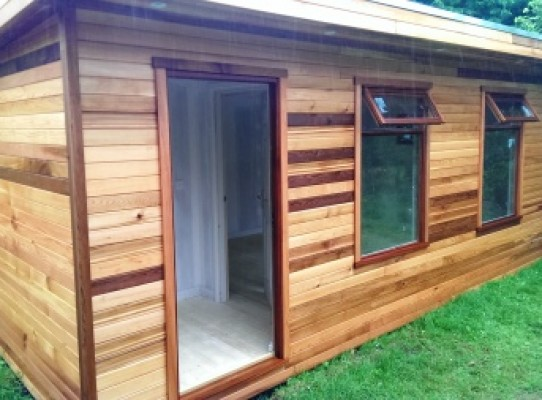 cedar cladded garden room with pent roof
