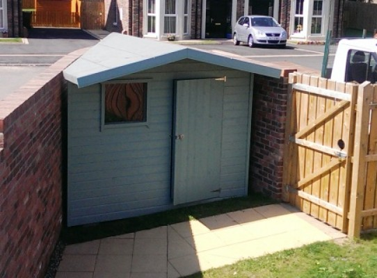 Custom built garden shed to perfectly fit a tight angled corner