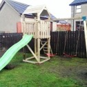 wooden climbing frames and double swing set