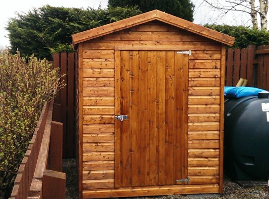 Garden shed with teak wood preservative finish
